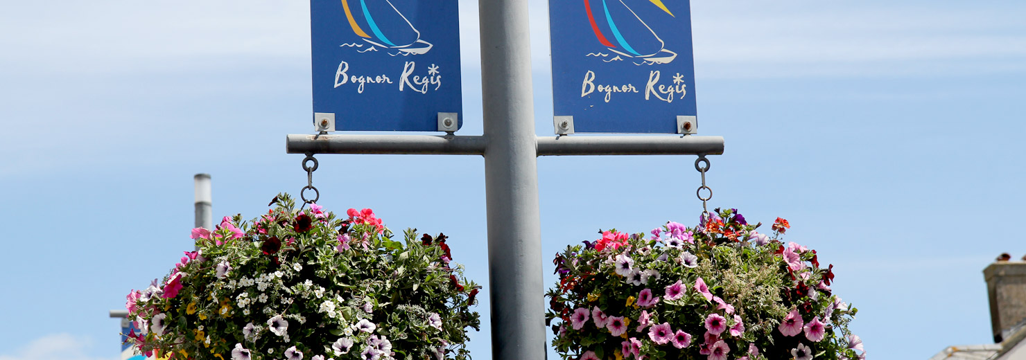 Two flowering hanging baskets on a lampost in Bognor Regis